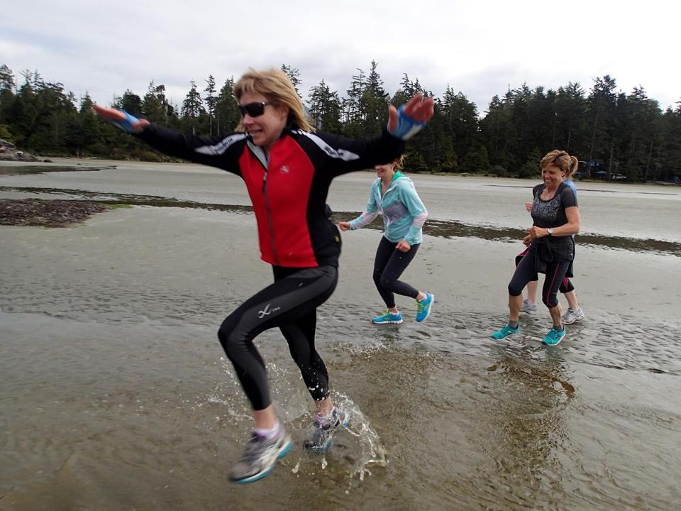 Runners on Mackenzie Beach at a ChiRunning retreat on Vancouver Island.