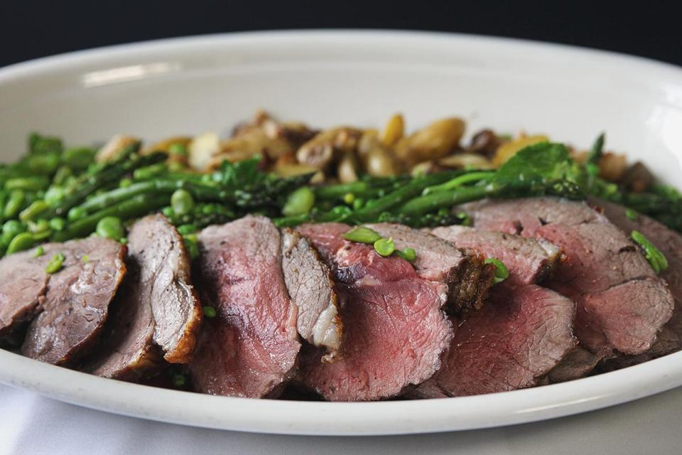 A roast leg of lamb with spring vegetables made by chef Jeremy Sewall.