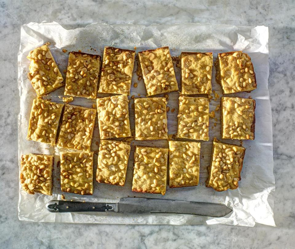 Pictured, orange, pine nut, and white chocolate bars. TIP Keep pine nuts (along with other nuts) in the freezer to maintain freshness.