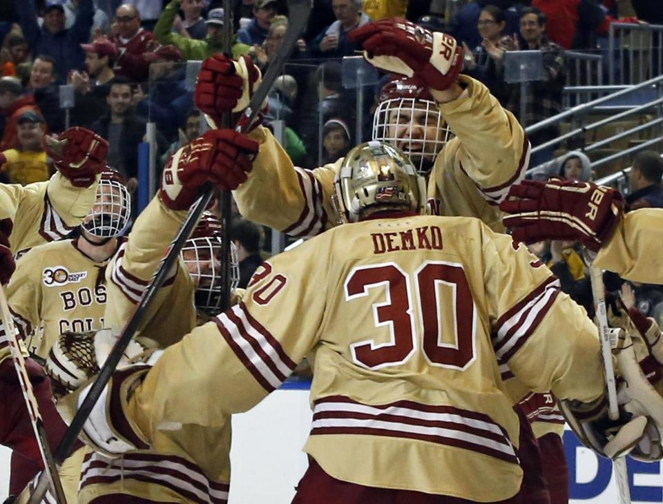 BC hopes its players mob goalie Thatcher Demko in victory twice more this season. Elise Amendola/Associated Press