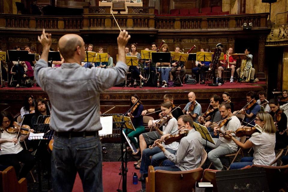 "Conductor Gil Rose leads the orchestra during Odyssey Opera's rehearsal of Wagner's ""Rienzi""  last September."