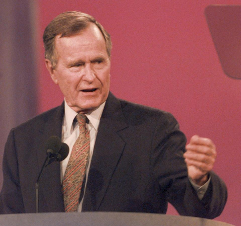 Former president George Bush, pictured here in 1996, promised he wouldn't raise taxes during a 1988 debate with Michael Dukakis —  but he did anyway.