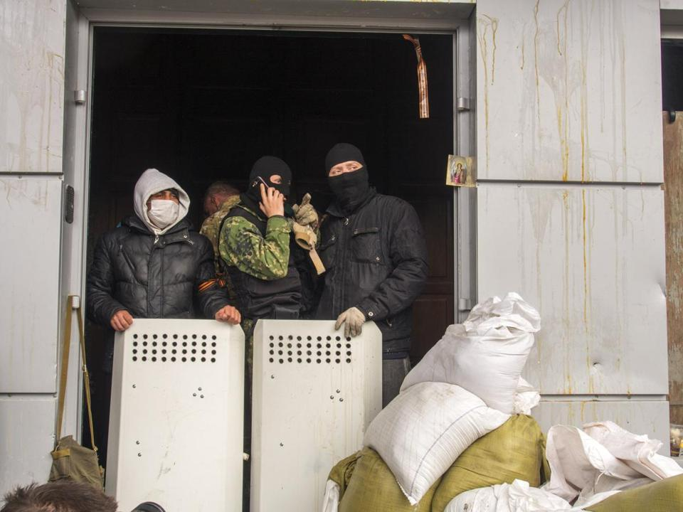 Masked pro-Russian activists guarded an entrance to the Ukrainian regional office of the Security Service in Luhansk.
