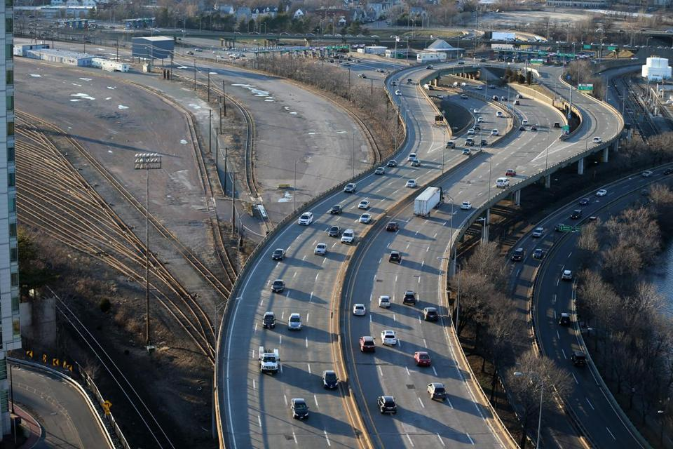 The Mass. Pike at Allston is seen with the rail yard at left.