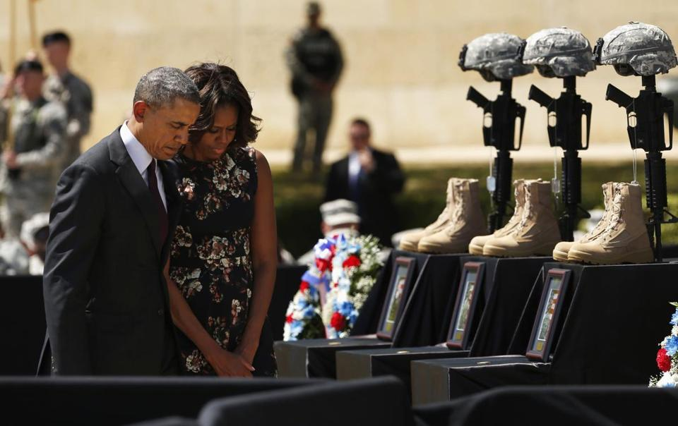 President Obama and his wife, Michelle, paid their respects Wednesday to the three men slain last week at Fort Hood.