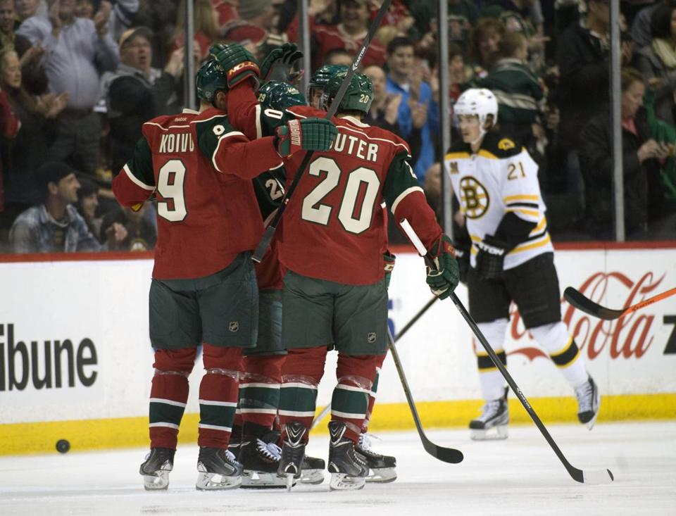 The Minnesota Wild celebrate a goal by forward Jason Pominville (29) in the first period against the Bruins at Xcel Energy Center.