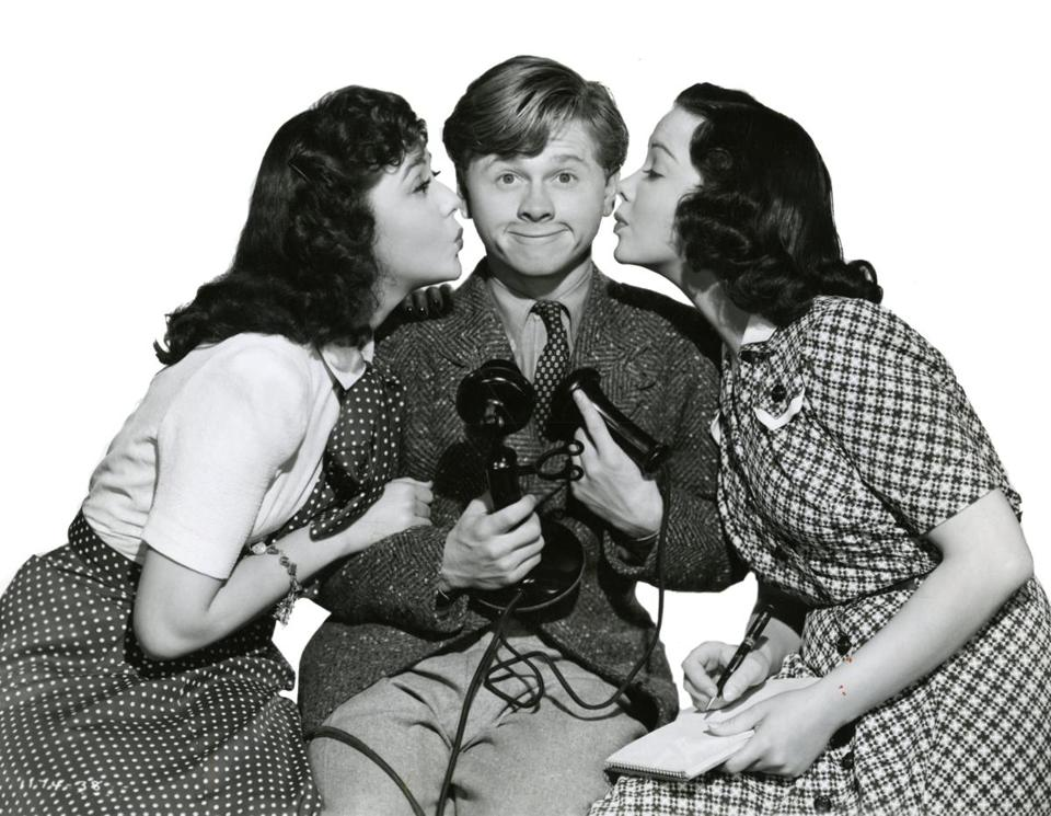 "Mickey Rooney played Andy Hardy (here flanked by Ann Rutherford, left, and Kathryn Grayson) in the 1941 film ""Andy Hardy's Private Secretary."""