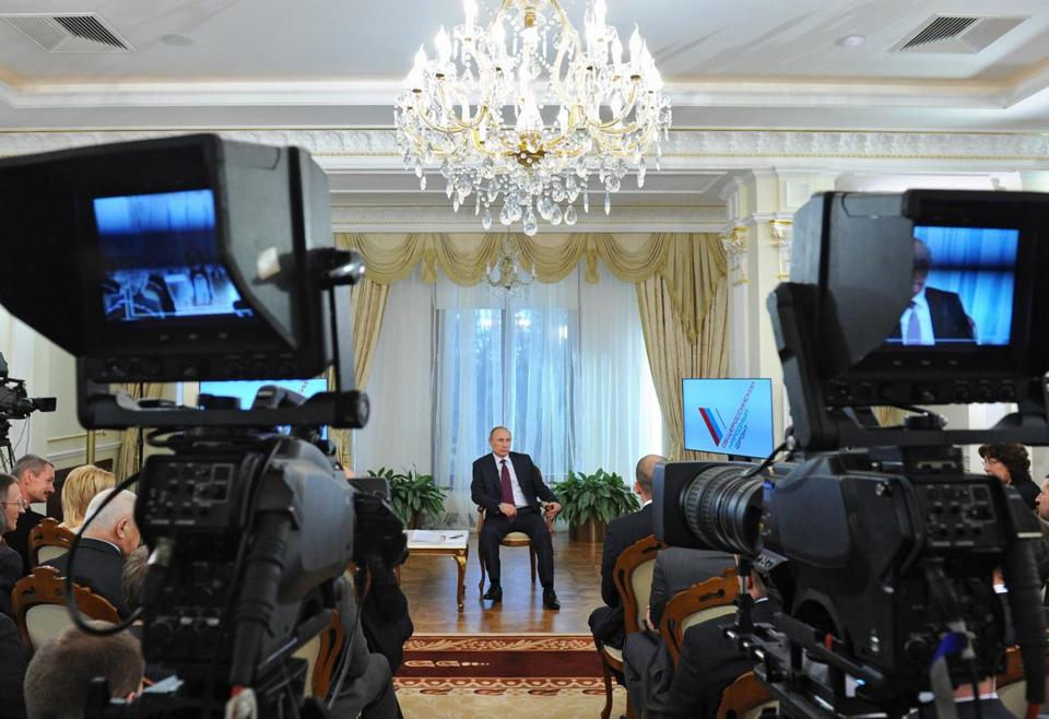 Russian President Vladimir Putin spoke with All-Russia People's Front activists during their meeting in Moscow.
