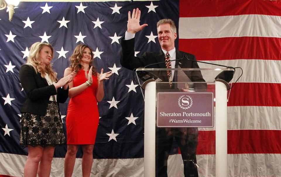 With his daughters Arianna, left, and Ayla, former Massachusetts U.S. Senator Scott Brown arrives to announce his candidacy to run for U.S. Senator in New Hampshire, Thursday, April 10, 2014 in Portsmouth, N.H. (AP Photo/Jim Cole)