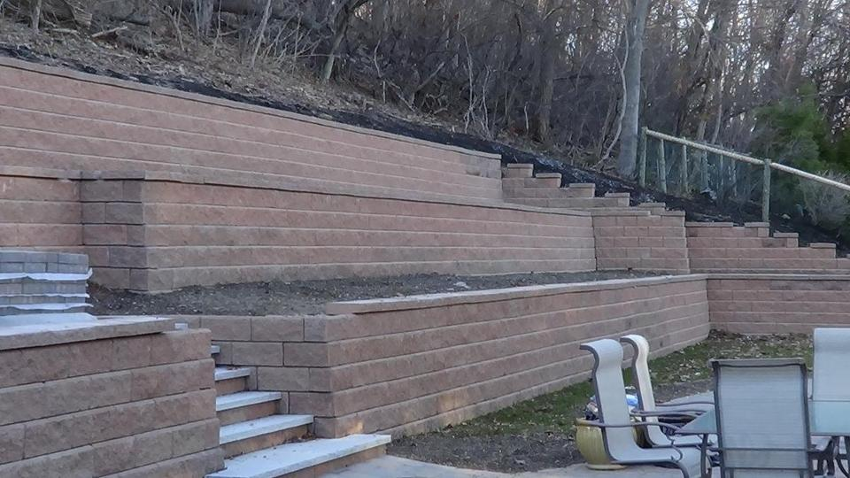 A view of the retaining wall installed by Albert Pinkhasov in his Newton backyard without a required special permit.