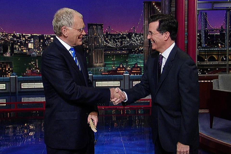 "Stephen Colbert (right) will succeed David Letterman as host of CBS's ""Late Show"" next year."
