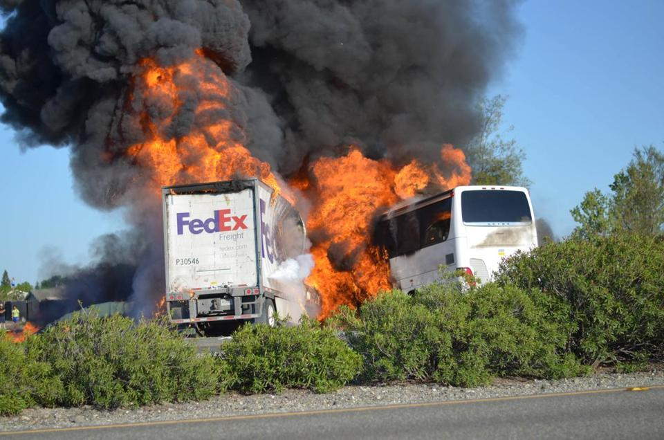 Massive flames engulfed a tractor-trailer and a tour bus just after they collided near Orland, Calif.