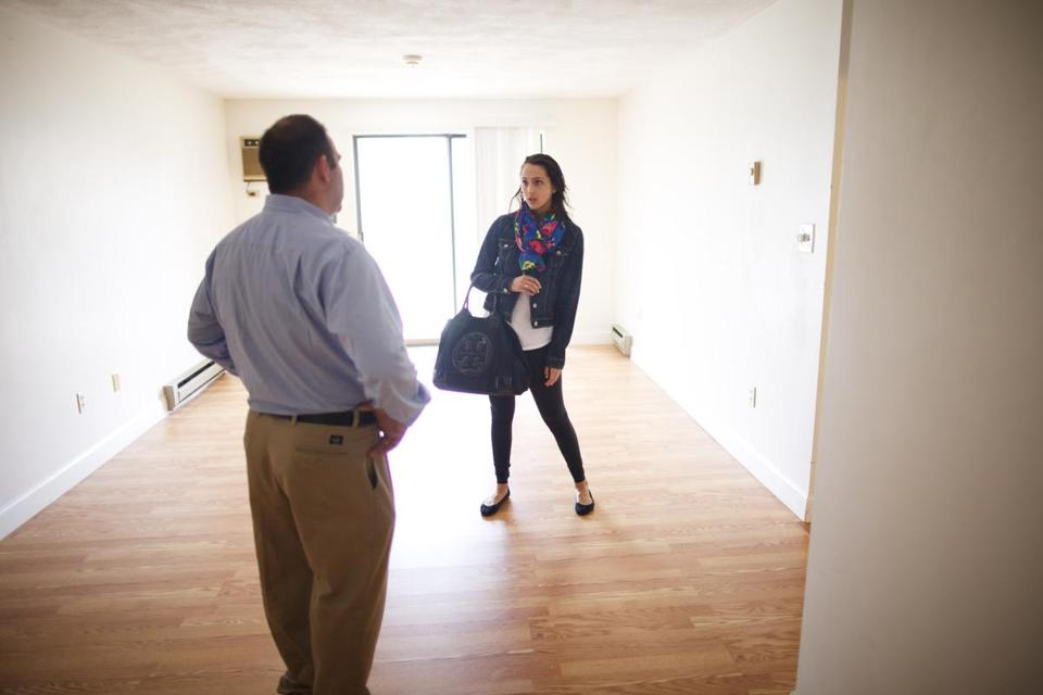 Phil Ragusa, the owner of Boston Premier Properties in Quincy, showed a rental unit to Sarah Dunphy, a UMass Boston student.