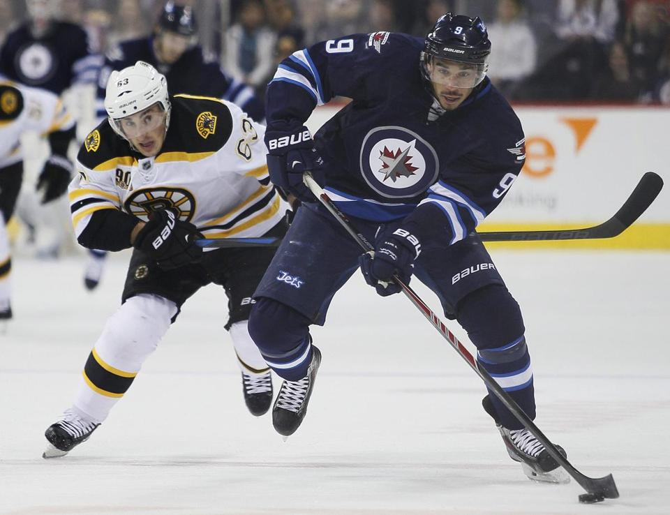 Brad Marchand chased down Evander Kane in the second period.