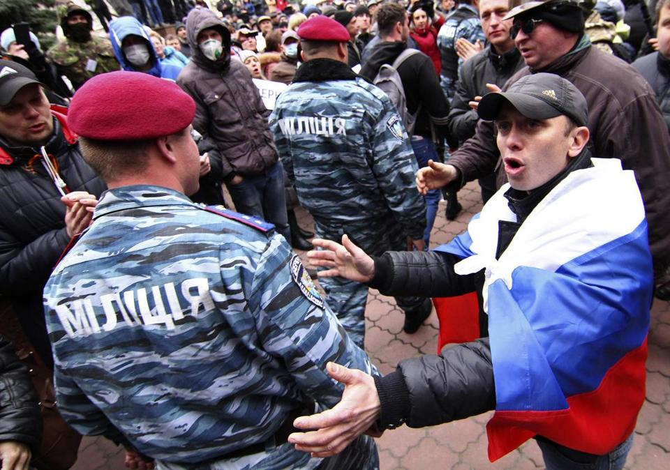 Members of the Berkut, a disbanded police riot squad, arrived in Donetsk on Saturday and occupied the police station.