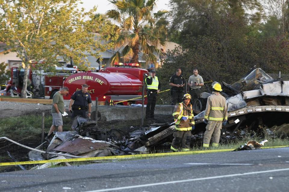 Emergency crews were at the scene Thursday a crash between a semi truck and a bus on on Interstate 5 near Orland, Calif.