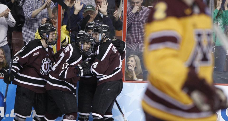 Union's Daniel Ciampini (center left) reacted to his goal in the first period.