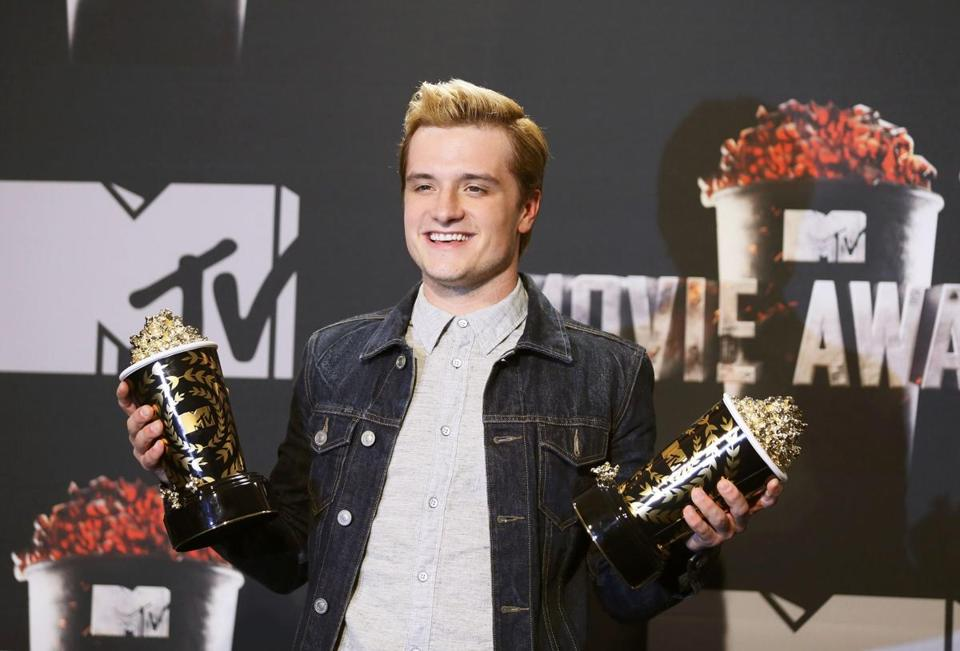 "Actor Josh Hutcherson posed with his awards for Best Male Performance and Best Movie of the Year for ""The Hunger Games: Catching Fire"" at this year's MTV Movie Awards."