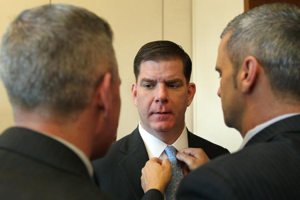 Mayor Martin Walsh gets an impromptu tie adjustment from state Representative Carlo Basile at an event last month. Walsh told a group last week that he'll fight against marijuana dispensaries.
