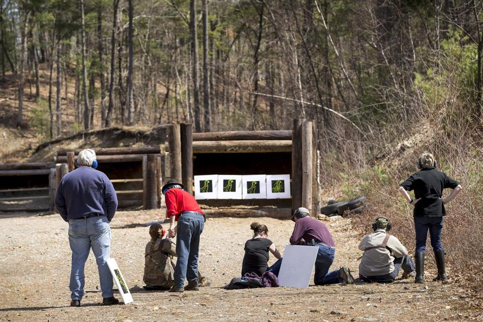 Participants in the state's Becoming an Outdoors-Woman seminar for first-time turkey hunters get some tips at Shirley Rod and Gun Club.