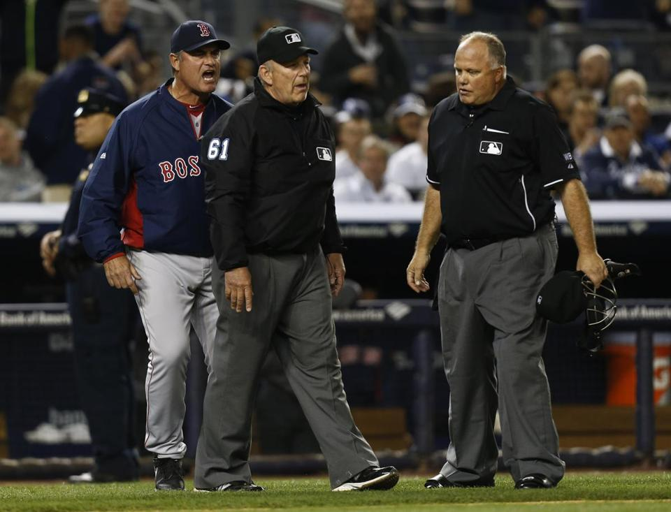 John Farrell objects to the overturning of call on replay in Sunday night's game. Photo by Jeff Zelevansky/Getty Images