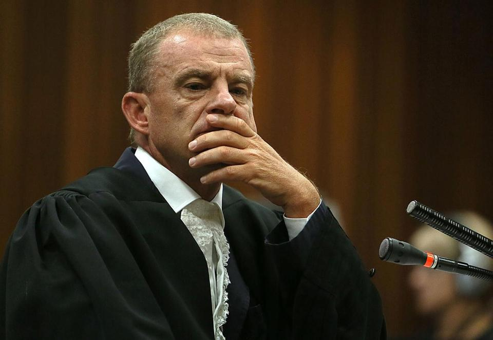 """Who should we blame for the fact that you shot her?'' prosecutor Gerrie Nel (pictured) asked Pistorius."