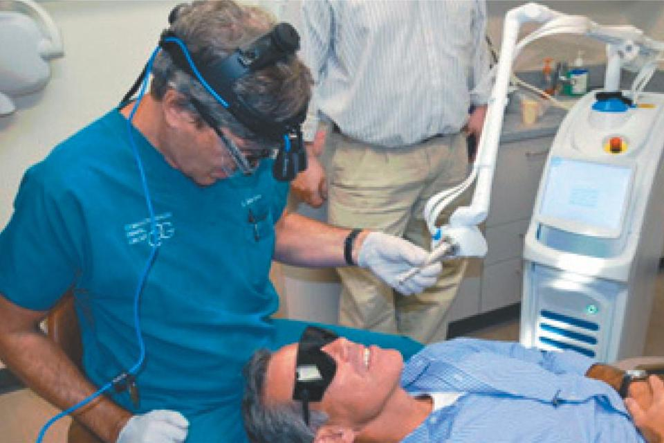 Dr. Mark Mizner of Commonwealth Dental Group in Boston performed the first cavity filling using the Solea laser last year on Convergent chief executive Mike Cataldo.