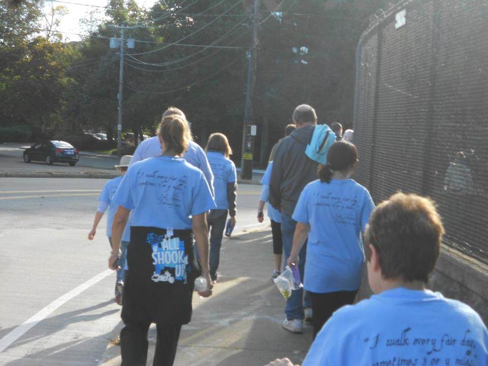 Participants at last year's John Adams Health Walk wore distinctive blue shirts with a quote from the president.