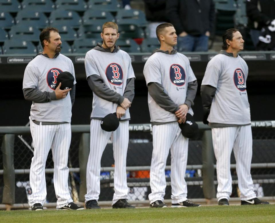White Sox players, from left, Paul Konerko, Chris Sale, Nate Jones, and Scott Downs, wore t-shirts honoring the Marathon anniversary before Tuesday's game.