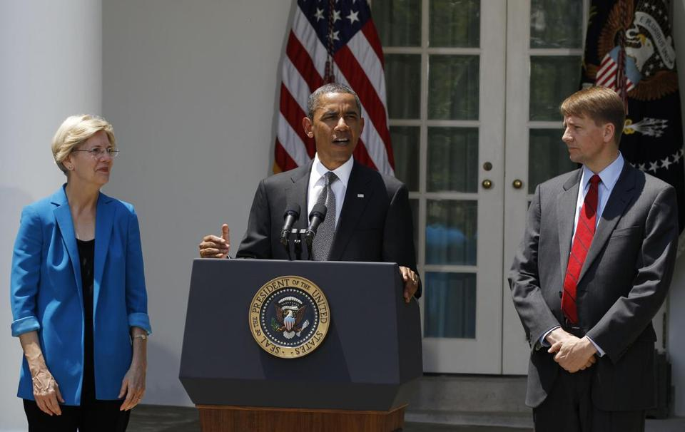 In 2011, President Obama named Richard Cordray (right) head of the Consumer Financial Protection Bureau. Elizabeth Warren wrote about the formation of the agency in her book.