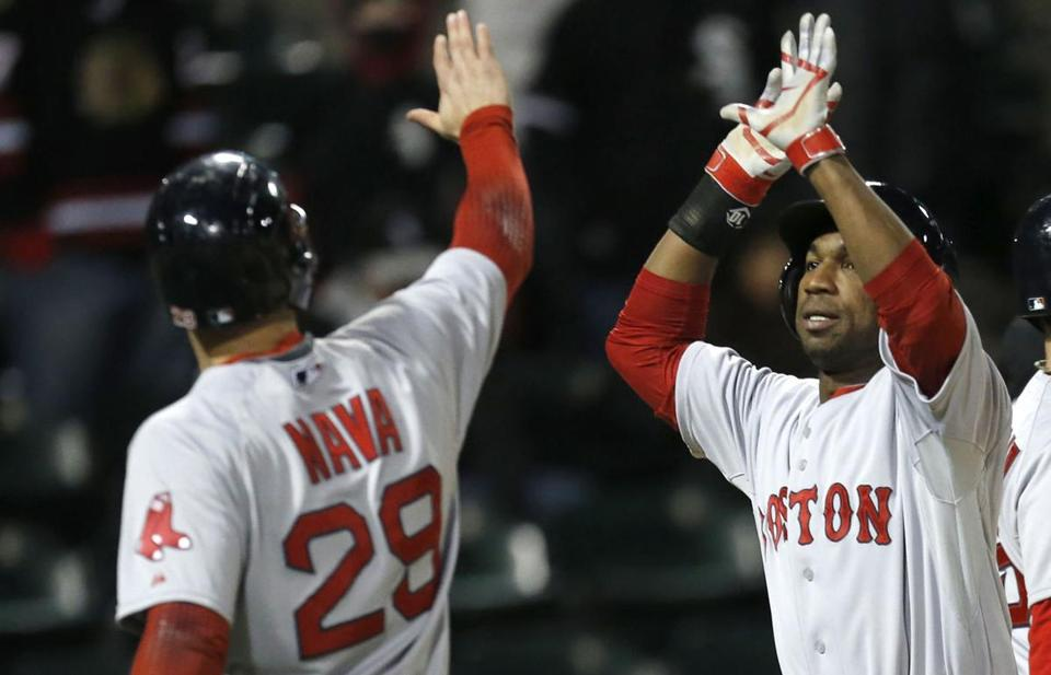 Daniel Nava (left) and Jonathan Herrera celebrated after scoring on a 14th-inning double by Jackie Bradley Jr.