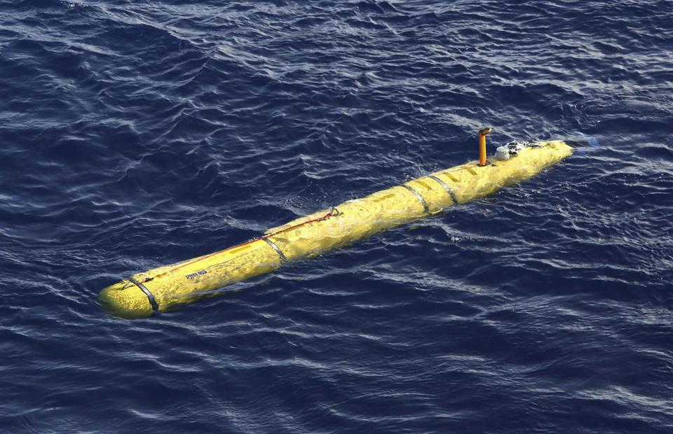 The Bluefin-21 Autonomous Underwater Vehicle sits in the water after being deployed from the Australian Defence Vessel Ocean Shield in the southern Indian Ocean on Thursday.