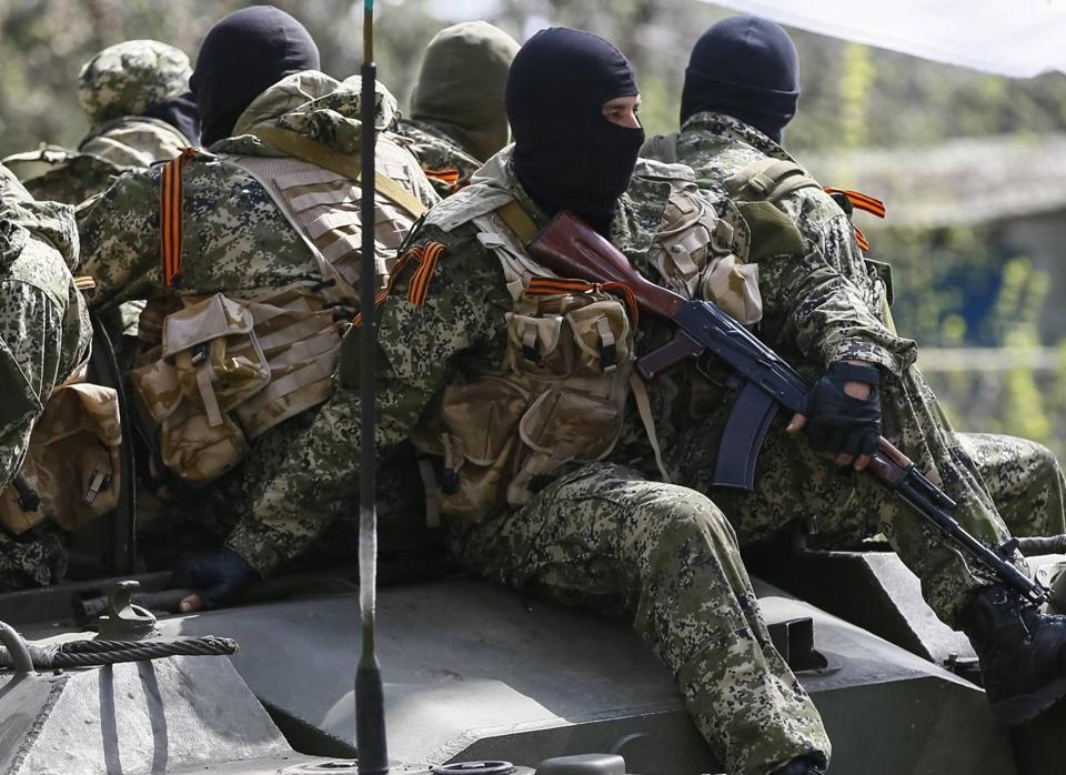 Armed men, wearing a ribbon widely associated with pro-Russian protests in Ukraine, drove an armoured personnel carrier in Slaviansk, Ukraine, on Friday.