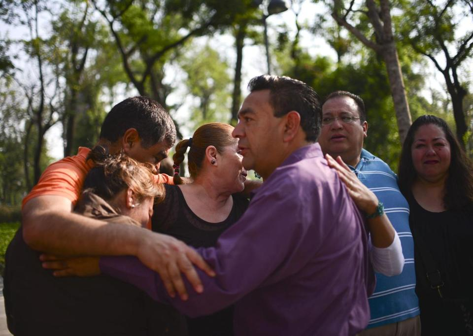 People comforted each other after a strong earthquake rattled Mexico City on Friday.
