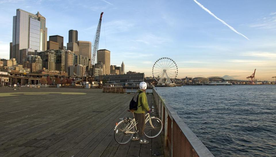 The author's wife, Michelle Holmes, stops to survey the skyline and Elliot Bay, sweeping all the way to Mount Rainier.