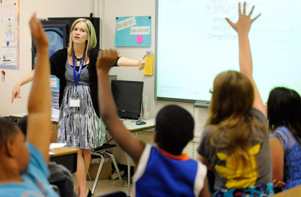 A teacher at a Delaware elementary school that began implementing the Common Core standards taught a fifth-grade language arts class.