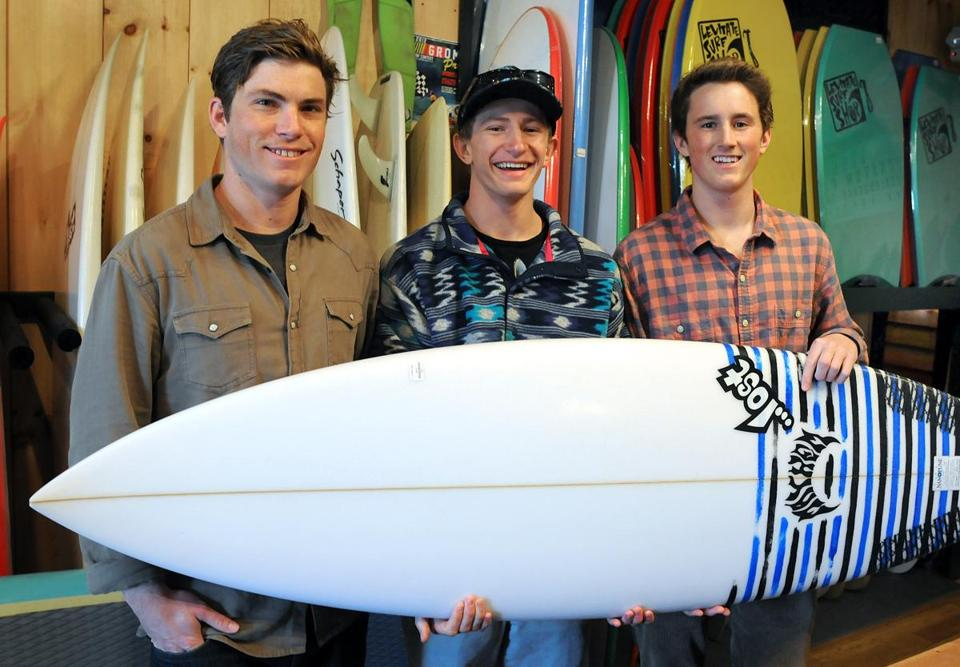 Dan Hassett (left), owner of the Levitate surf and skate shop in Marshfield, is mentoring Duxbury High's Calder Stames (center) and Kevin Gerraughty in their senior project.