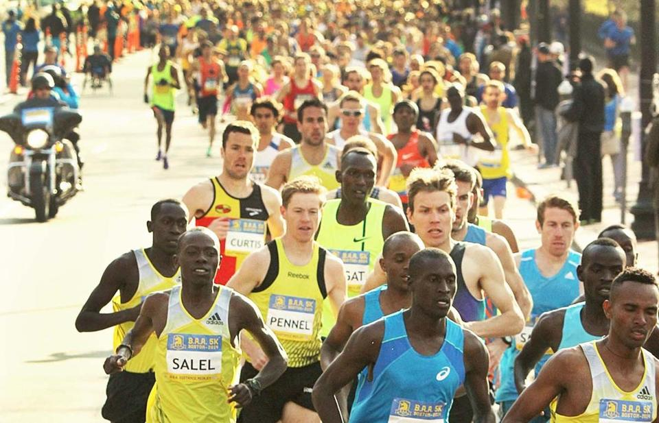 Elite runners in the 5K race made their way down Beacon Street in Boston.