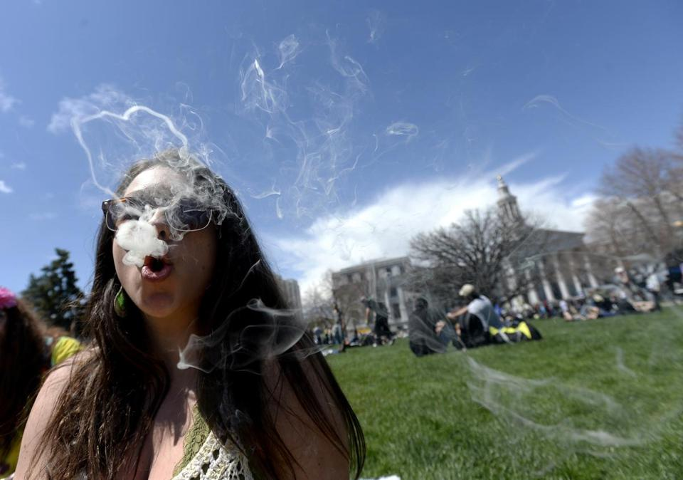 A woman smoked during the 4/20 rally at the Civic Center Park in Denver, where a massive festival was held.