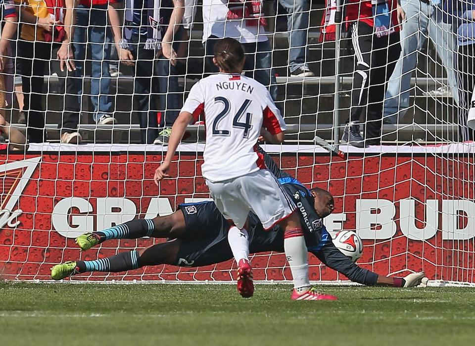 Lee Nguyen watches his penalty kick get past goalie over Sean Johnson to help the Revolution tie the Fire. (Jonathan Daniel/Getty Images)