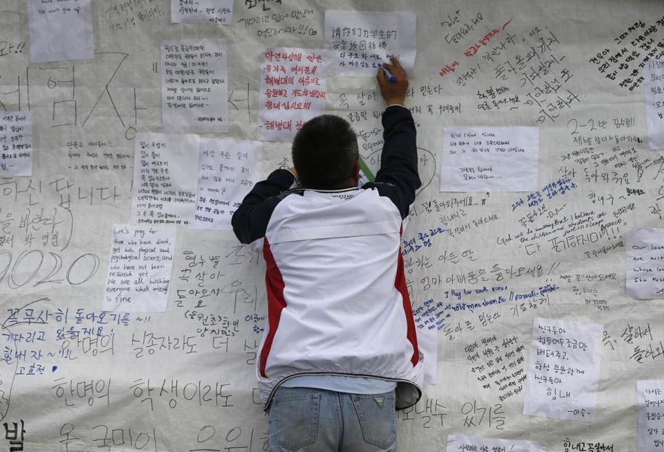 A man added a message wishing for the safe return of missing passengers of the ferry, which capsized last week.