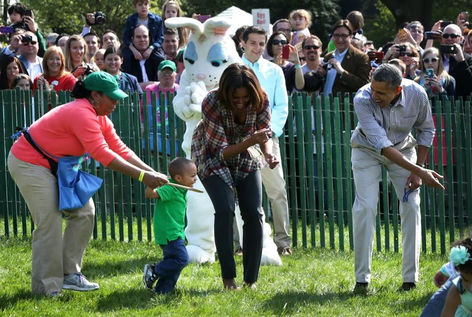 President Obama and his wife, Michelle, cheered on participants in the 136th White House Easter Egg Roll on the South Lawn Monday.