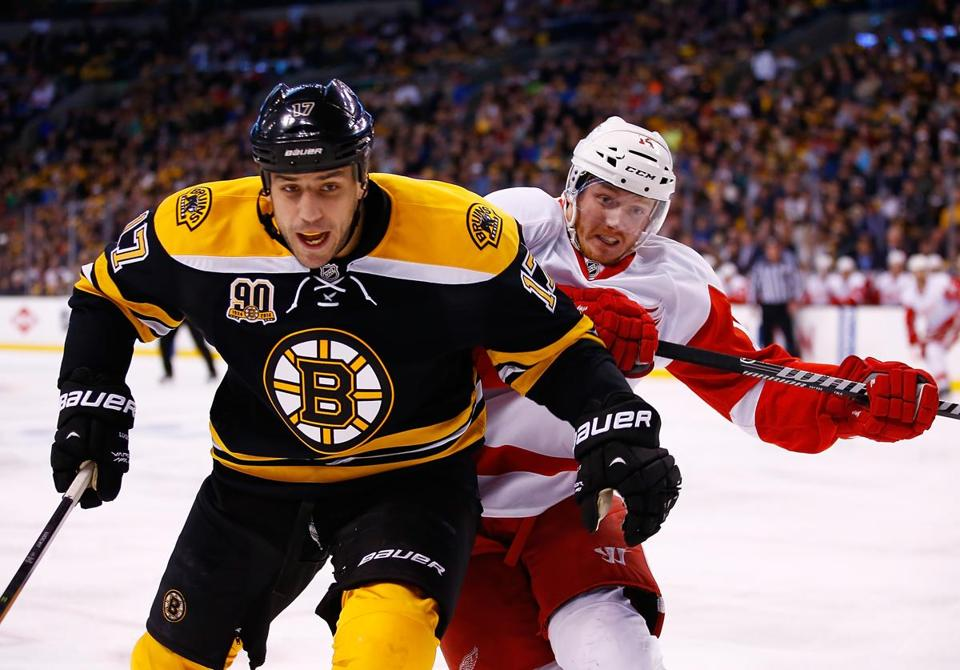 Bruins forward Milan Lucic, who was at the center of some controversy after his actions in Game 1, keeps Gustav Nyquist on his back during Sunday's win.