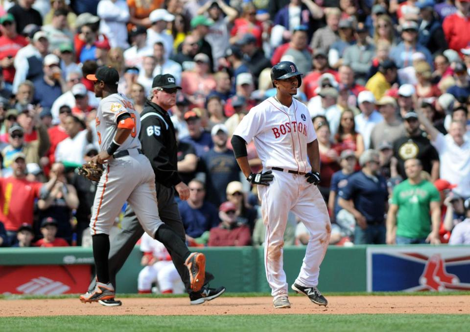 Xander Bogaerts grimaced after running into the final out of the eighth inning.