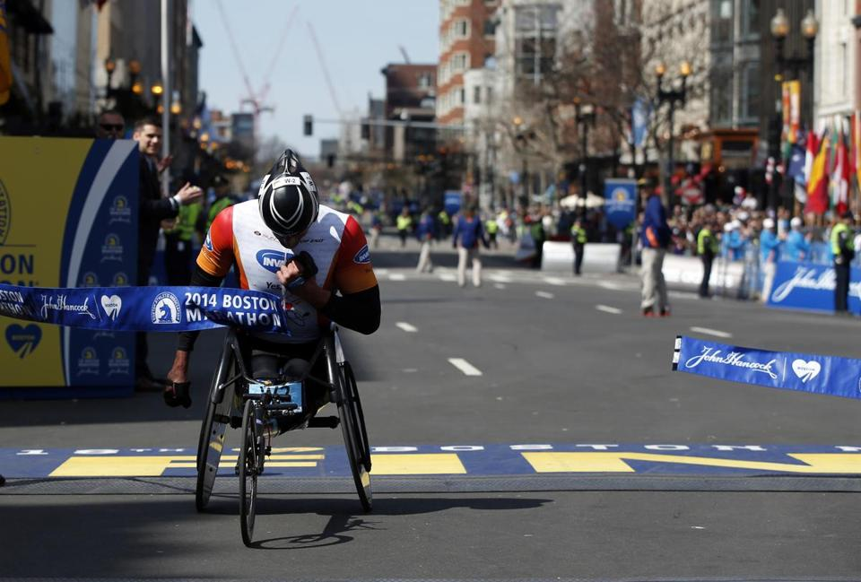 Ernst Van Dyk was the first to cross the finish line on Monday when he won the men's wheelchair race.
