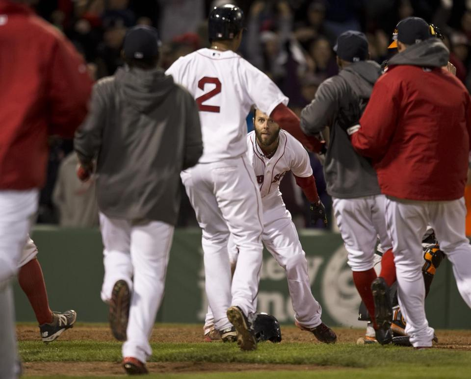 Dustin Pedroia and the Red Sox celebrated the 6-5 win over the Orioles.