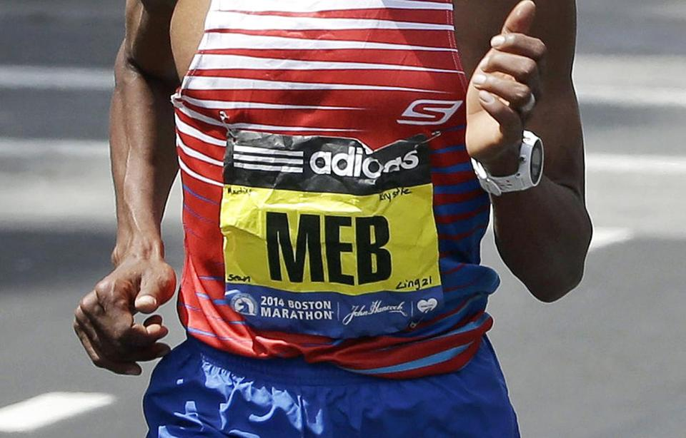 Meb Keflezighi, of San Diego, Calif., ran in the 118th Boston Marathon with the names of those killed in the 2013 bombings, and the MIT officer allegedly slain by the bombing suspects, on his bib.