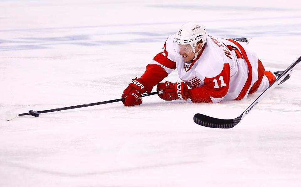 Daniel Alfredsson was ruled out of Game 3, believed to be because of a back injury. Jared Wickerham/Getty Images