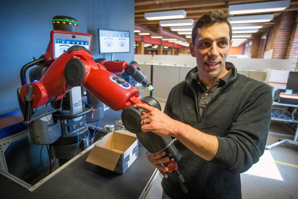 Robert White showed off Baxter, an industrial robot designed to work along with humans on production lines.