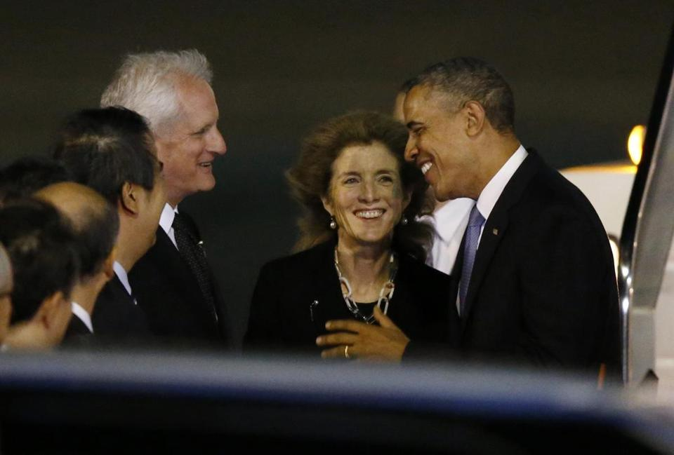 President Obama greeted US Ambassador Caroline Kennedy, her husband, Edwin Schlossberg, and Japanese officials upon his arrival in Tokyo Wednesday.